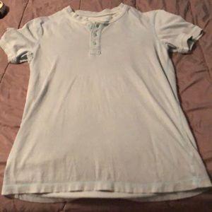 Light blue button up t-shirt. 100% cotton